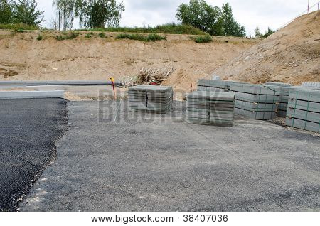 New Asphalt Road Construction Site. Tiles Curbs