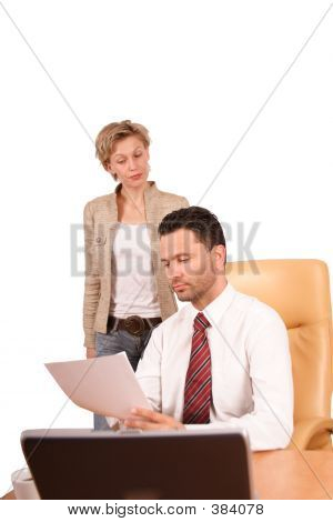 Woman Presenting Report To The Businessman