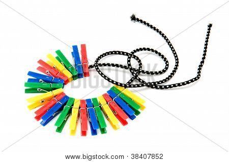Clothespins On A Rope Isolated On White Background