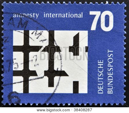 GERMANY- CIRCA 1974: stamp printed in Germany dedicated to Amnesty International shows Broken Bars o