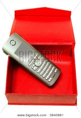 Gray (Silver) Mobile (Radio) Telephone And Red Cardboard Box.