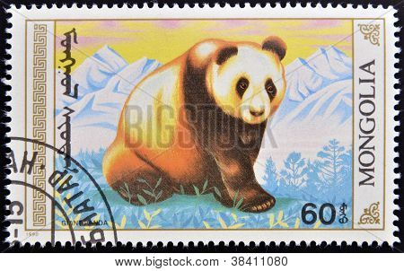 MONGOLIA - CIRCA 1990: stamp printed in Mongolia shows a giant panda circa 1990