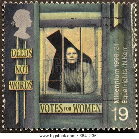 UNITED KINGDOM - CIRCA 1999: A stamp printed in Great Britain shows Suffragette behind Prison Window
