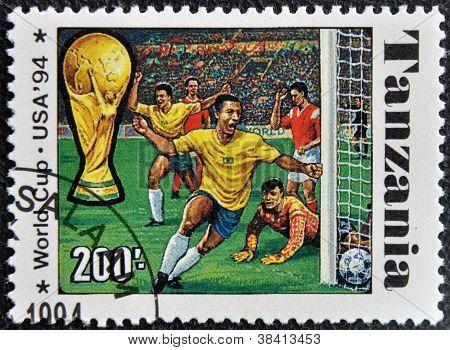 TANZANIA - CIRCA 1994: A stamp printed in Tanzania dedicated to FIFA World Cup USA 1994 shows footba