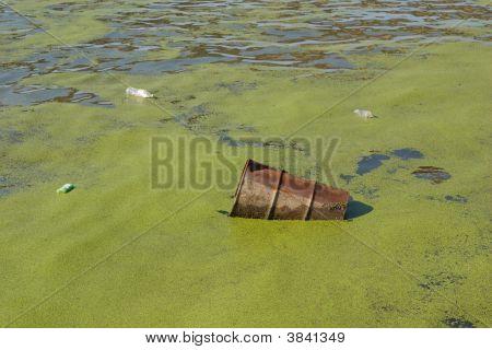 Metal Barrel Floating In River
