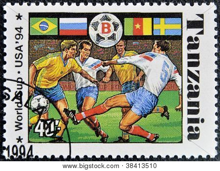 TANZANIA - CIRCA 1994: A stamp printed in Tanzania dedicated to FIFA World Cup USA 1994 shows footba