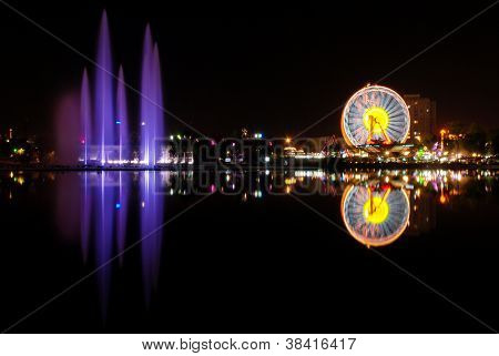 Luna park and water show reflection
