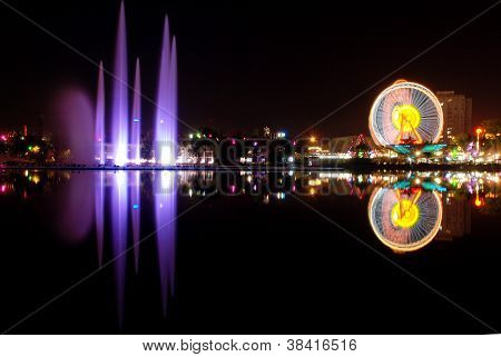 Luna park and city reflection