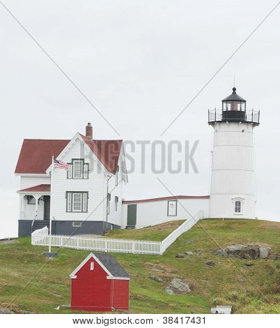 Nubble lighthouse in Maine on cloudy day