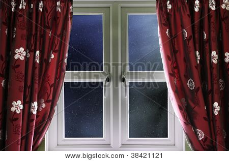 Starry night sky through a window