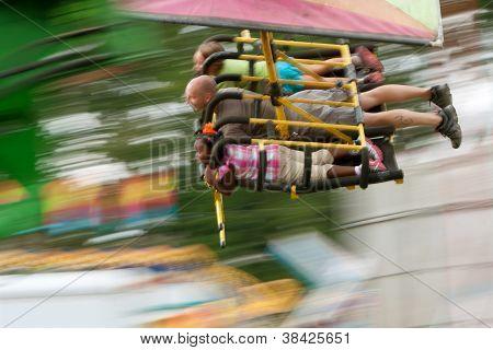 Motion Blur Of People On Speedy Carnival Ride