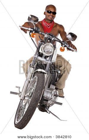 Isolated Man On Motorbike