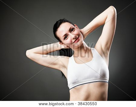 Beautiful Sporty Woman Stretching Her Body