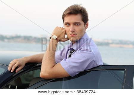 Relaxing Young Handsome Man On Car Background, Outdoor