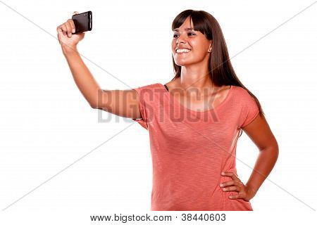 Young Woman Taking A Picture With Her Mobile