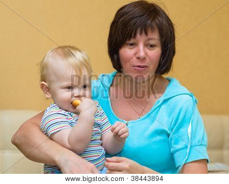 Grandma Holds The Newborn Grandson