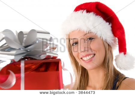Portrait Of Beautiful Woman Dressed As Santa With Gift