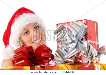 Girl With Santa\'S Hat And Colorful Christmas Gifts