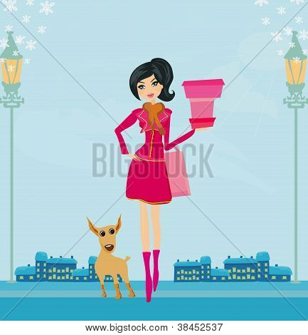winter girl with gift box and her dog