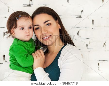 Happy Smiling Mother With Her Baby