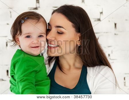 Happy Smiling Mother With Lovely Baby Girl