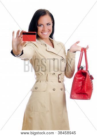 Smiling Woman With Red Credit Card And Bag. Isolated On White.