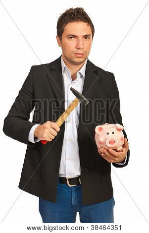 Nervous Man  Holding Hammer And Piggybank