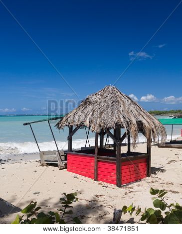 Bar And Tables On Beach Covered In Sand