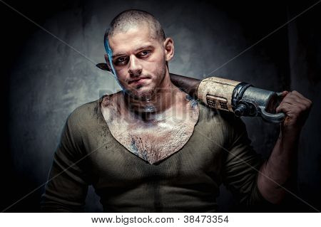 Muscular Young Man With Jackhammer Posing Over Grey Background
