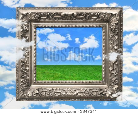 Silver Picture Frame Against A Blue Sky