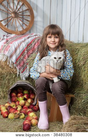 Portrait Of Girl Villager With Cat Near Pail, Apples In Hayloft
