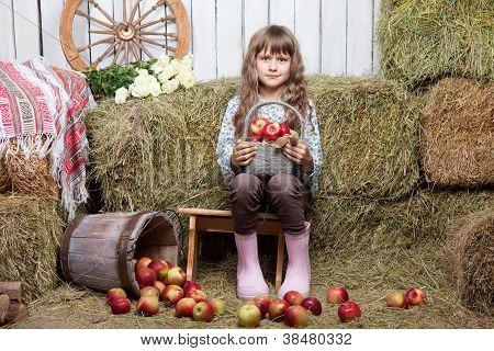 Portrait Of Girl Villager With  Basket Apples In Hayloft