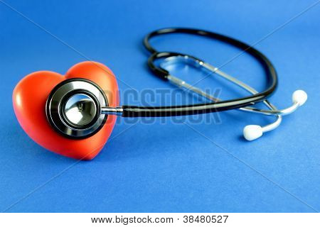 Stethoscope And Red Heart On Blue Background
