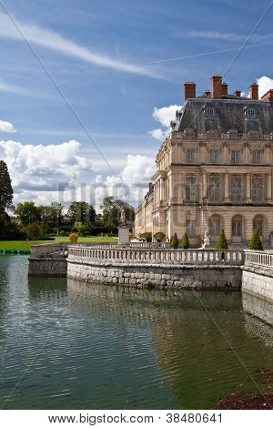 Medieval Royal Castle Fontainbleau And Lake Near Paris In France