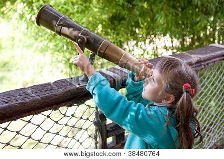 Little Girl Preschooler Discovers Surroundings Through Old-style Telescope