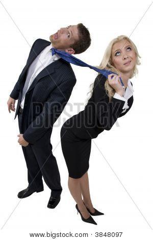 Female Pulling Tie Of Businessman