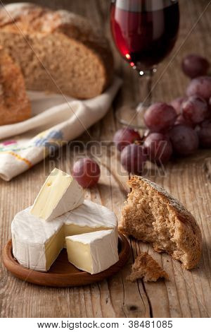 Traditional Normandy Camembert Cheese With Homemade Bread, Glass Of Wine