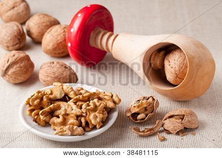 Nut Kernels In Plate, Circassian Walnuts, Nutcracker, Nutshell On Linen Tablecloth