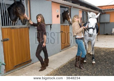 Two Girls With Horses
