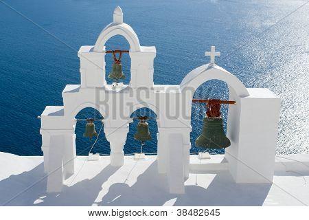 Calm Sea, White Church Arch, Cross, Bells Island Santorini Greece