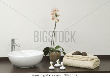 Scene Of Relaxing Treatment With Towels And Stones