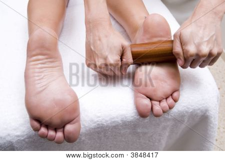 Relaxing Treatment With Bamboo In Feets