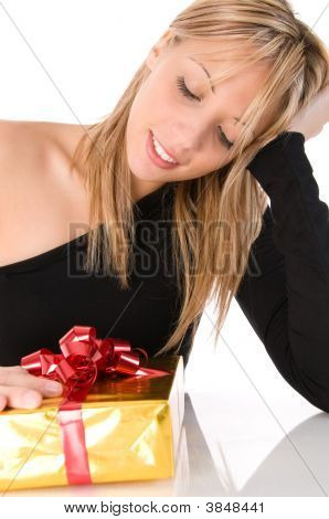 Young Beautiful Girl Looks At The Gift