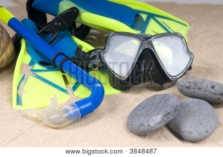 Mask Fins And Tube In Sand Background