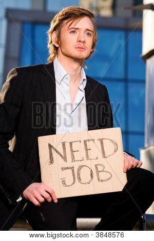 Young Businessman Holding Sign Need Job Outdoors