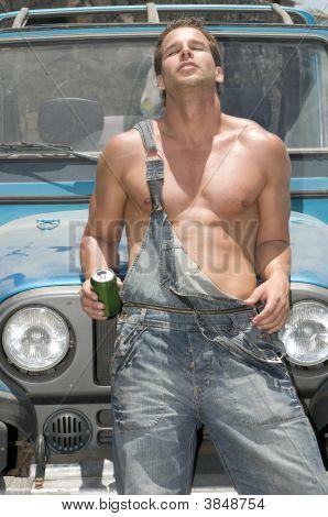 Sexy Man Drinking Beer Under The Sun