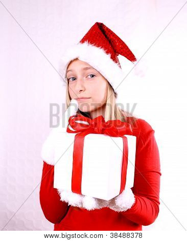 Dreaming, Young Girl As Mrs. Santa With A Gift