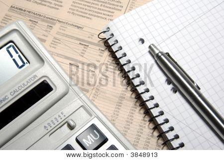 Calculator, Pen, Notebook And Financial Newspaper. Conceptual.