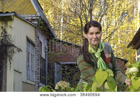 A Young Woman Caring For Flowers.