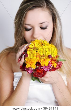 woman Smelling A Bouquet.jpg